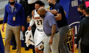 Denver Nuggets star Jamal Murray 'devastated' after a season-ending ACL injury, coach Michael Malone says