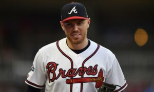 Baseball player Freddie Freeman astounds a youthful Phillies fan who parted with a home run ball to Atlanta Braves fan