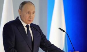Vladimir Putin signs law finishing Russia's Open Skies treaty with the US