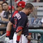 Washington Nationals' Kyle Schwarber exits the game with an evident right leg injury